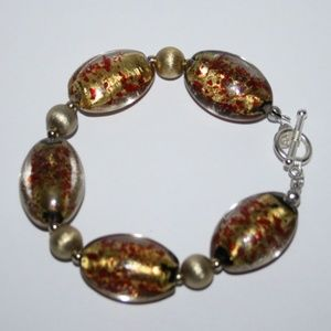 NWOT gold and red glass toggle bracelet